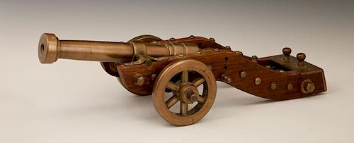 Unusual Bronze and Oak Cannon, early 20th c., on a