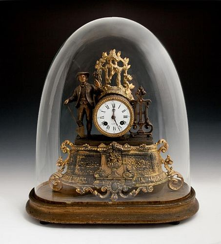 Gilt and Patinated Spelter Figural Mantel Clock. 1