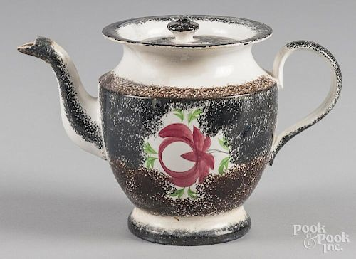 Black and brown rainbow spatter teapot with Adams rose decoration, 7'' h.