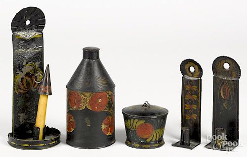Two toleware tea caddies, together with three sconces, all with later floral decoration