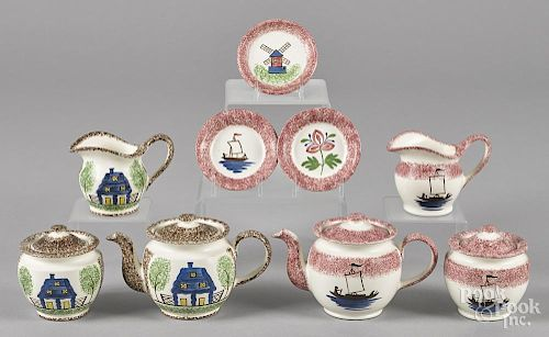 Two reproduction spatter miniature tea services, nine pieces total.