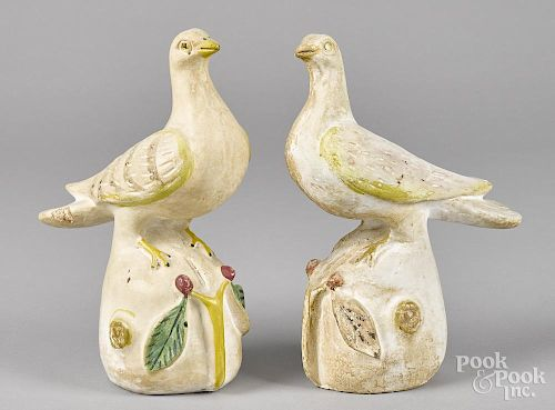 Two Pennsylvania chalkware pigeons, late 19th c., 10 3/4'' h. and 11'' h.