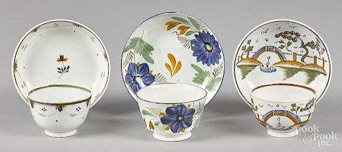Three English pearlware cups and saucers, 19th c.