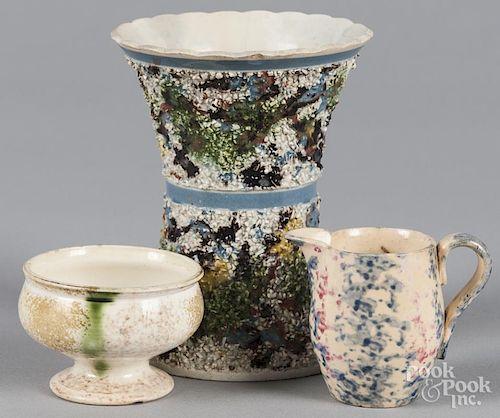 Mocha sand vase, 5'' h., together with a sponge creamer, 2 1/2'' h., and a spatter master salt