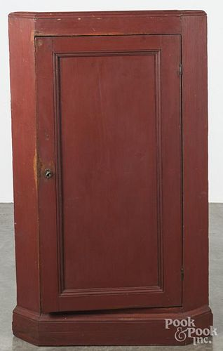 Painted pine corner cupboard base, 19th c., retaining an old red surface, 53'' h., 31'' w.