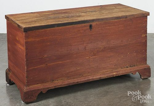 Painted pine blanket chest, early 19th c., retaining an old red surface, 25'' h., 45 3/4'' w.
