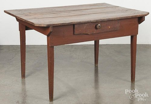 Painted pine tavern table, 19th c., retaining an old red surface, 30'' h., 50'' w., 36'' d.