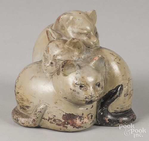 Painted composition doorstop of three cats, 5 1/2'' h.