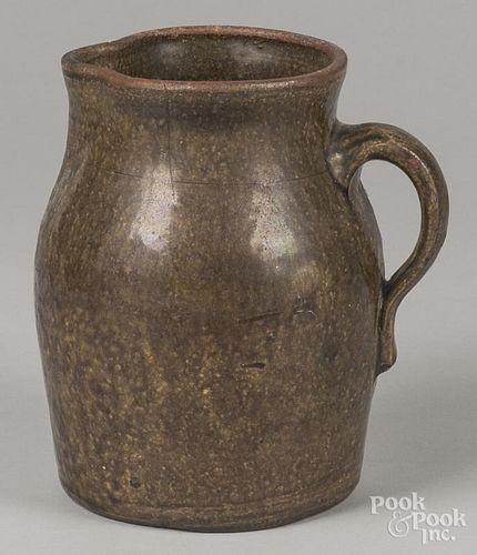 Southern alkaline glaze stoneware pitcher, 19th c., 9'' h.
