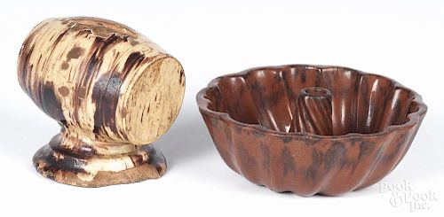 Redware Turks head mold, 2 1/2'' h., 7'' w., together with a barrel-form bank, 4 1/2'' h.