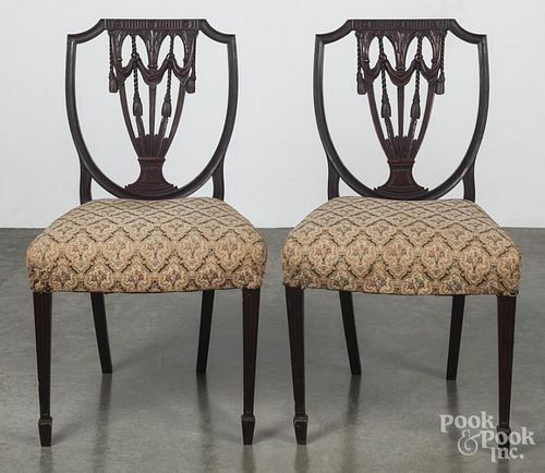 Pair of Federal style carved mahogany shieldback dining chairs, ca. 1900.