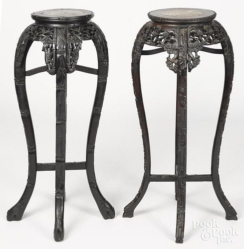 Two Chinese carved hardwood stands, early 20th c., with marble inset tops, 35 1/4'' h.