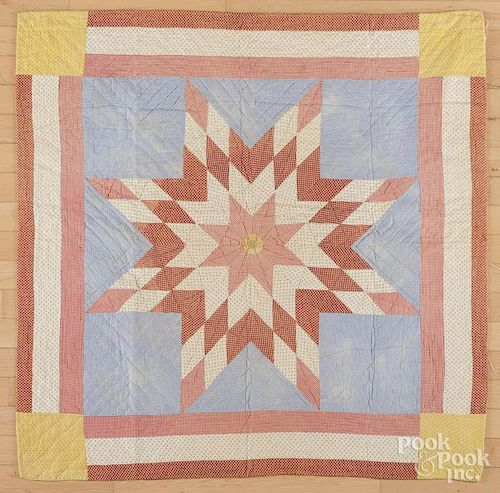 Pieced lone star crib quilt, early 20th c., 41'' x 41''.