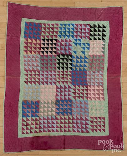 Flying geese variant quilt, early 20th c., 67'' x 55''.