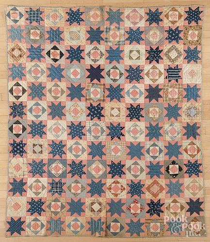 Pieced diamond and star in block quilt, late 19th c., 66'' x 79''.