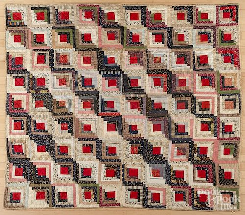 Pieced log cabin quilt, late 19th c., 75'' x 68''.