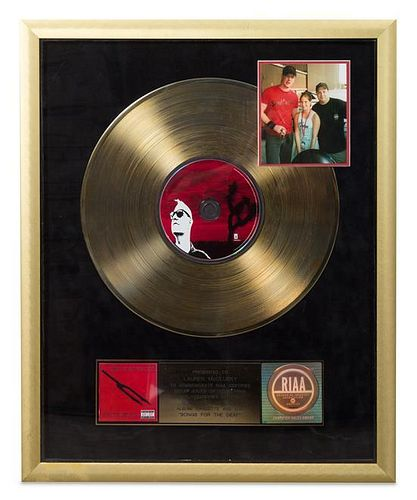 A Queens of the Stone Age: Songs for the Deaf RIAA Certified Gold Presentation Album 21 1/4 x 17 1/2 inches.