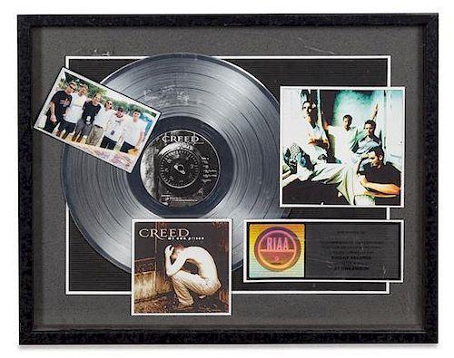 A Creed: My Own Prison RIAA Certified Platinum Presentation Album 17 x 20 3/4 inches.