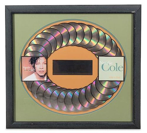 A Natalie Cole: Take a Look Presentation Album and Plaque 24 1/2 x 26 inches.