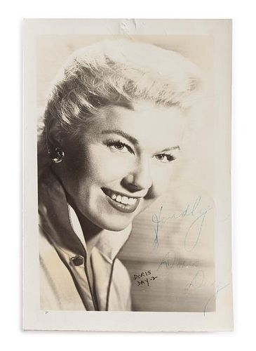 A Doris Day Autographed Lobby Card 5 x 3 1/4 inches.