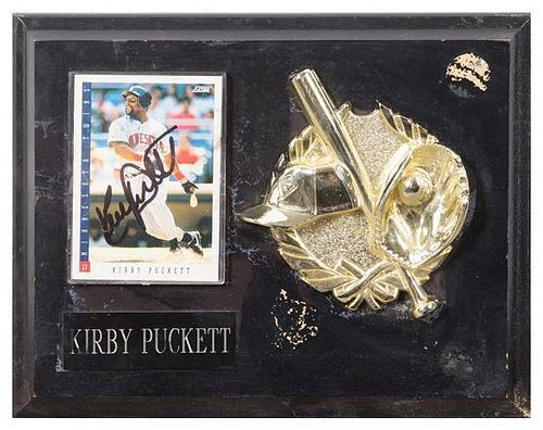 A Kirby Puckett Autographed Baseball Card Card 3 1/2 x 2 1/2 inches.