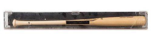 A Yogi Berra Autographed Baseball Bat Length of display case 63 3/4 inches.