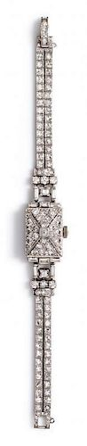 A Platinum and Diamond Surprise Wristwatch, Oscar Heyman Brothers, 23.40 dwts.