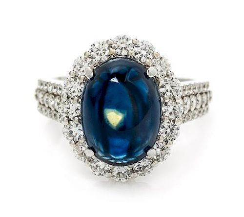 An 18 Karat White Gold, Sapphire and Diamond Ring, 4.90 dwts.