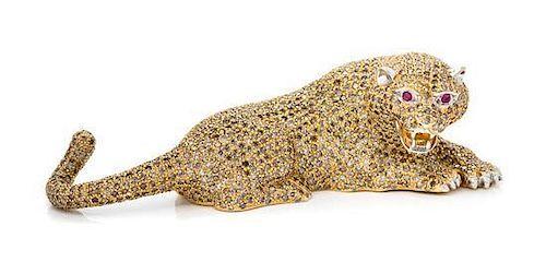 An 18 Karat Yellow Gold, Diamond and Ruby Jaguar Object, 53.80 dwts.