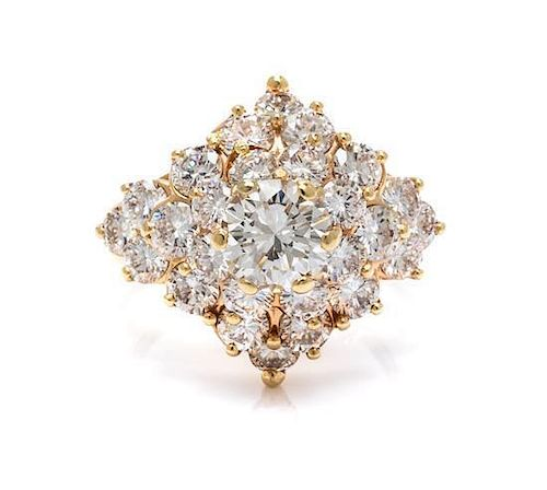 A 14 Karat Yellow Gold and Diamond Cluster Ring, 6.40 dwts.