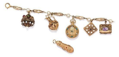 * A Yellow Gold Charm Bracelet with Six Charms, 45.90 dwts.