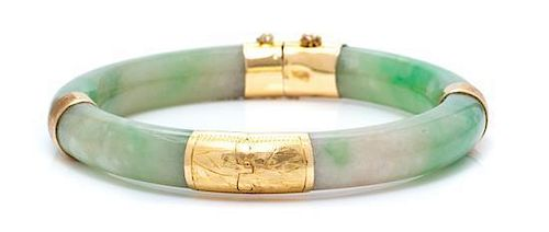 A Yellow Gold and Jade Bangle Bracelet, 29.20 dwts.