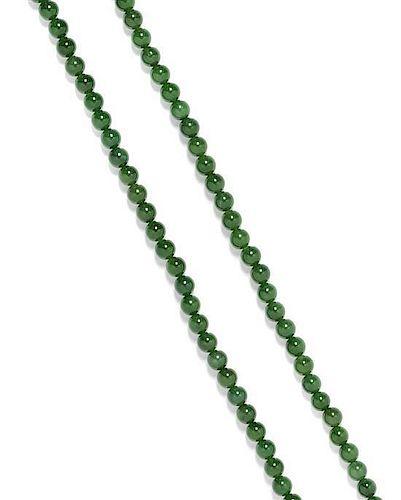 * A Single Strand Nephrite Jade Bead Necklace,