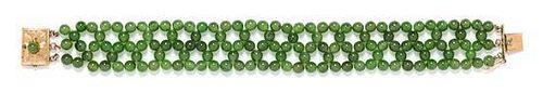 * An 18 Karat Yellow Gold and Nephrite Jade Bracelet, 11.20 dwts.
