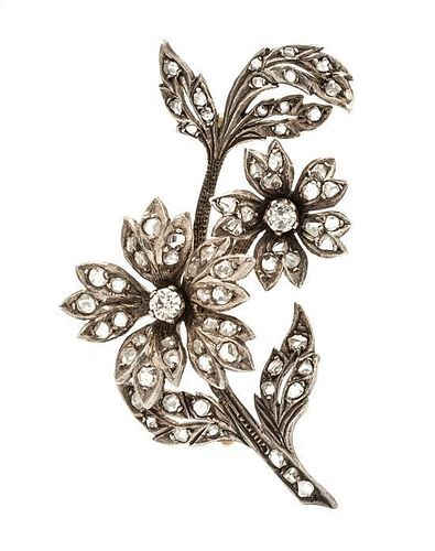 * A Silver Topped Gold and Diamond Flower Brooch, 8.70 dwts.