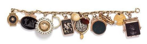 A 14 Karat Yellow Gold Charm Bracelet with 13 Attached Charms, 59.30 dwts.