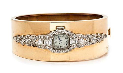 A 14 Karat Rose Gold, Platinum and Diamond Bangle Bracelet, 33.60 dwts.