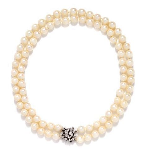 A 14 Karat White Gold and Diamond Double Strand Cultured Pearl Necklace,
