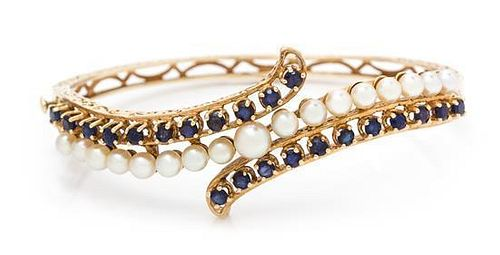 A Yellow Gold, Sapphire and Cultured Pearl Bangle Bracelet, 11.80 dwts.