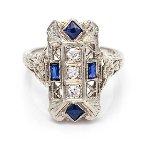 An 18 Karat White Gold, Diamond and Synthetic Sapphire Ring, 2.20 dwts.