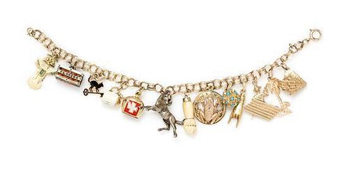 A 14 Karat Yellow Gold and Charm Bracelet with 13 Attached Charms, 19.80 dwts.