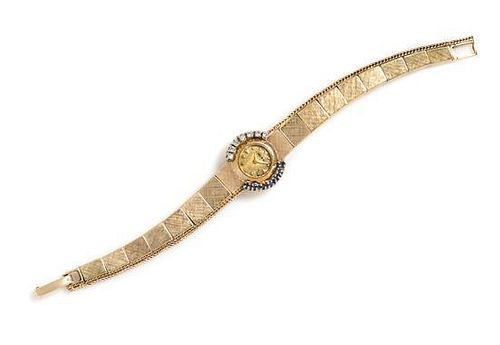 A 14 Karat Yellow Gold, Diamond and Sapphire Wristwatch, MOBA, 9.60 dwts.