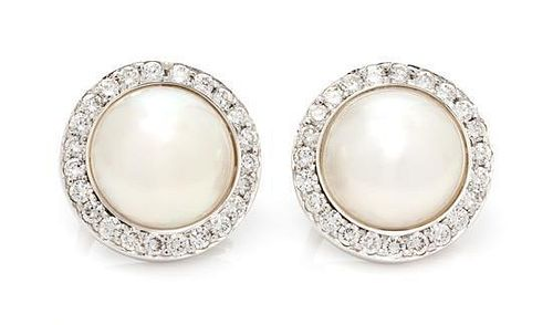 * A Pair of White Gold, Cultured Mabe Pearl and Diamond Earclips, 10.30 dwts.