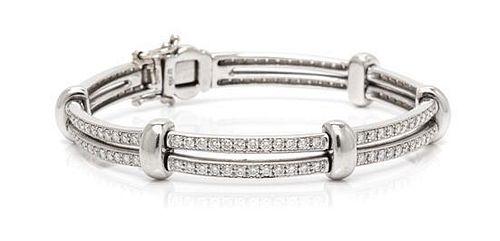 * An 18 Karat White Gold and Diamond Bracelet, 18.80 dwts.