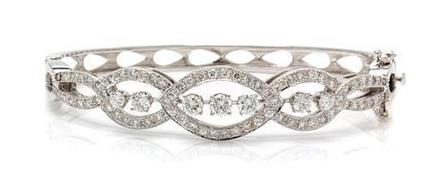 A White Gold and Diamond Bangle Bracelet, 11.60 dwts.
