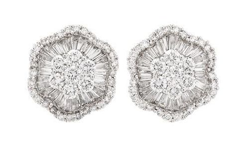 A Pair of 18 Karat White Gold and Diamond Earclips, 6.30 dwts.