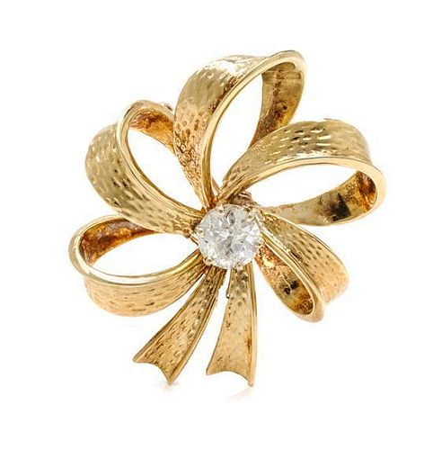 A Yellow Gold and Diamond Bow Pendant/Brooch, 9.80 dwts.