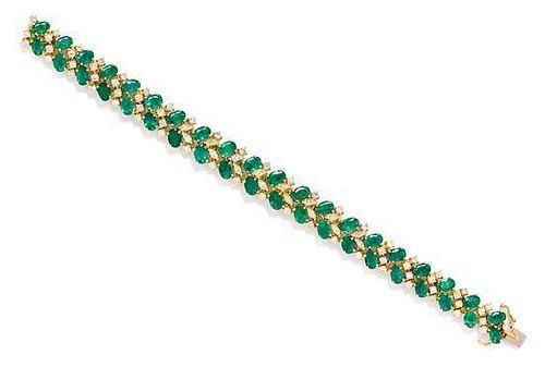 * An 18 Karat Yellow Gold, Emerald, and Diamond Bracelet, 19.90 dwts.