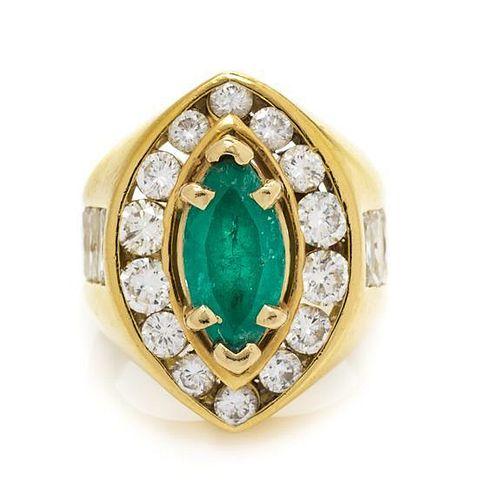 * An 18 Karat Yellow Gold, Emerald and Diamond Ring, 11.30 dwts.