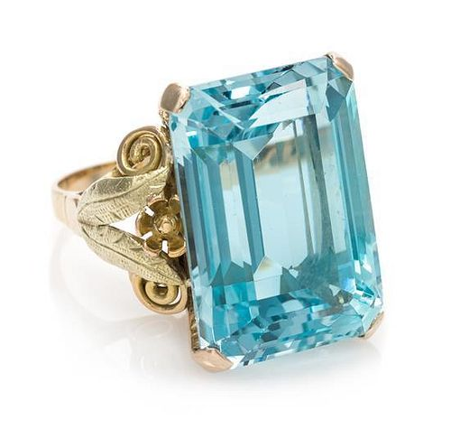 * A Bicolor Gold and Aquamarine Ring, 10.60 dwts.